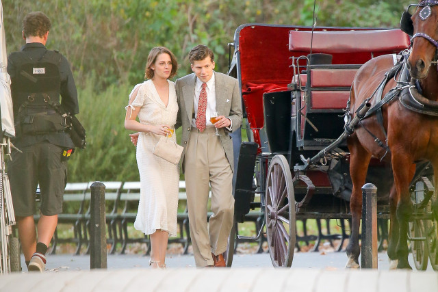 Kristen Stewart and Jesse Eisenberg are seen holding a glass of wine after taking a ride in a horse carriage in Central Park while they're filming scenes for The Untitled Woody Allen Project in New York City